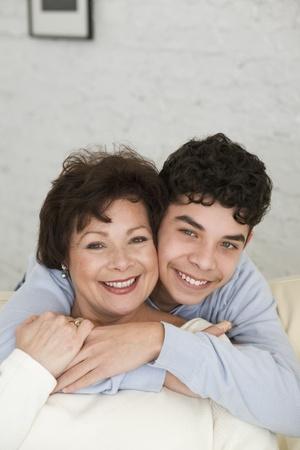 spectating: Hispanic grandmother and grandson hugging