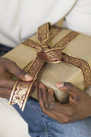 giver: African man holding gift