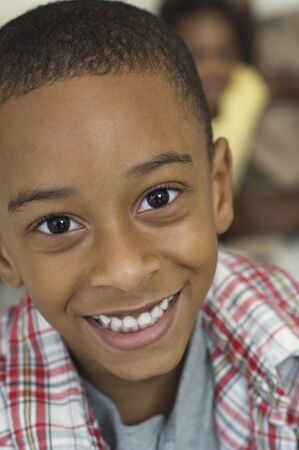 fathering: Close up of African boy smiling LANG_EVOIMAGES