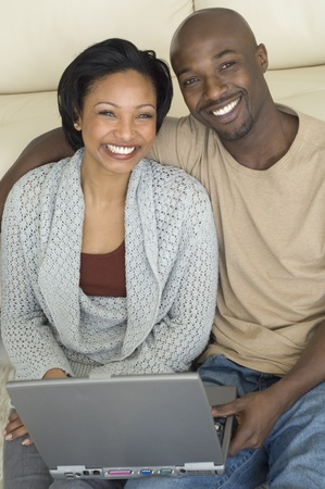 davenport: Portrait of African couple with laptop