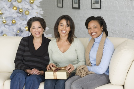 shrieking: African mother and adult daughters with Christmas gift