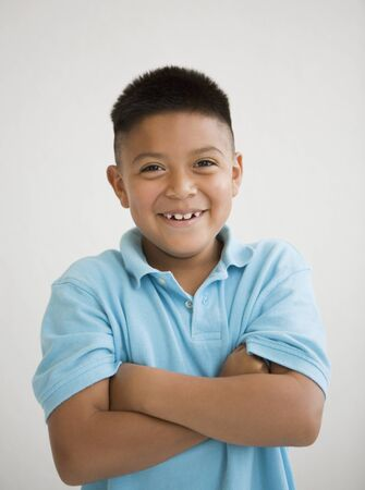 1 boy only: Hispanic boy with arms crossed