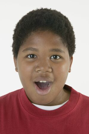 mischeif: African boy with mouth open