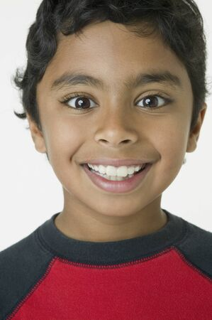 mischievious: Close up of Indian boy smiling
