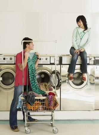 laundromat: Asian couple in laundromat LANG_EVOIMAGES