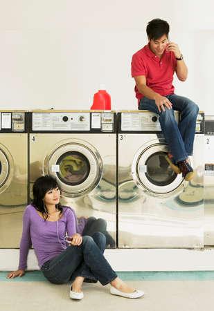 laundromat: Asian couple in Laundromat