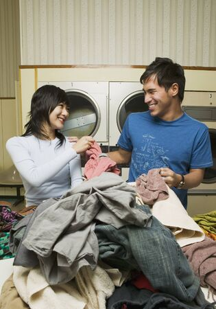 liable: Asian couple in Laundromat
