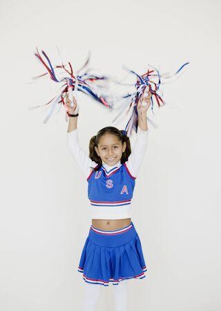 interrogating: Hispanic girl dressed as cheerleader