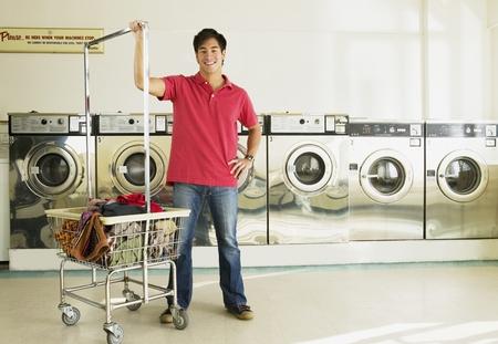 bathtowel: Asian man in laundromat