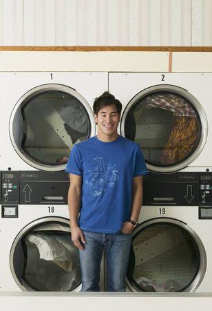 laundromat: Asian man in Laundromat