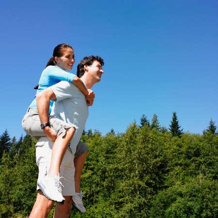 adventuresome: Man giving girlfriend piggy back ride