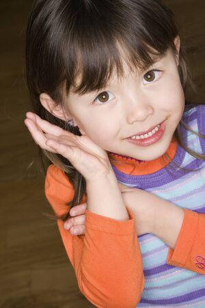 saturating: Close up of Asian girl smiling