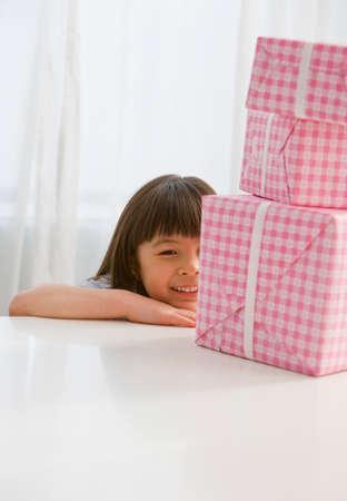 talker: Asian girl looking at gifts