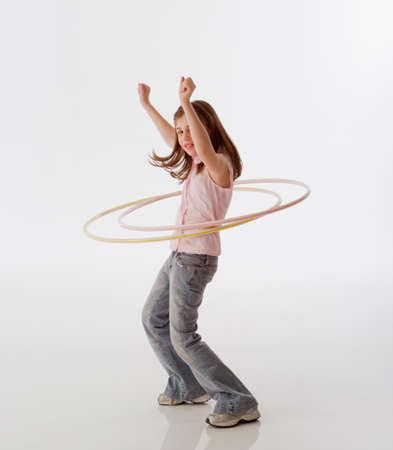 hula girl: Greek girl playing with hula hoops LANG_EVOIMAGES