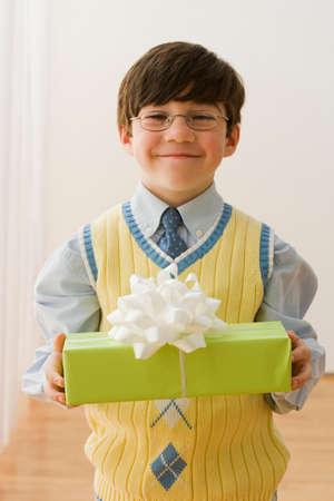 irish ethnicity: Greek boy holding gift LANG_EVOIMAGES