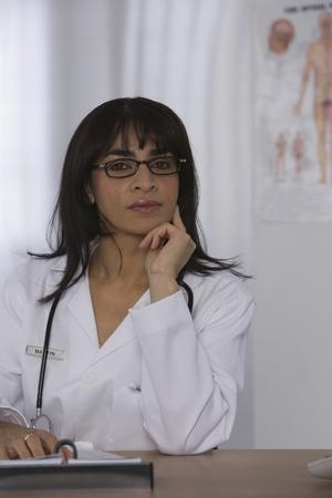 Female doctor sitting at desk