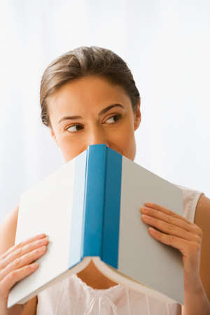 prevailing: Woman holding open book