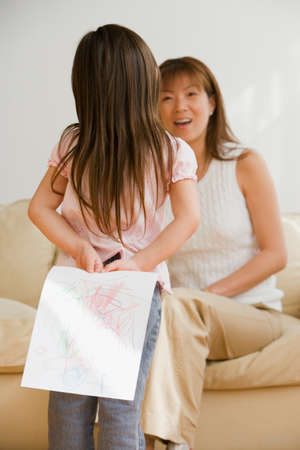 milepost: Asian girl surprising mother with drawing