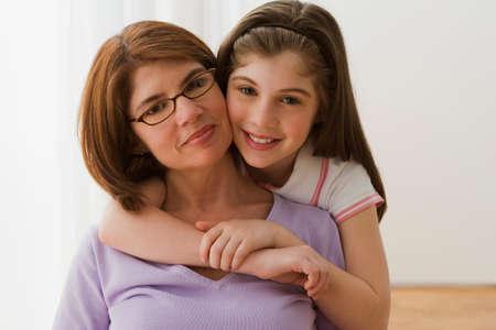 irish ethnicity: Irish mother and daughter hugging LANG_EVOIMAGES