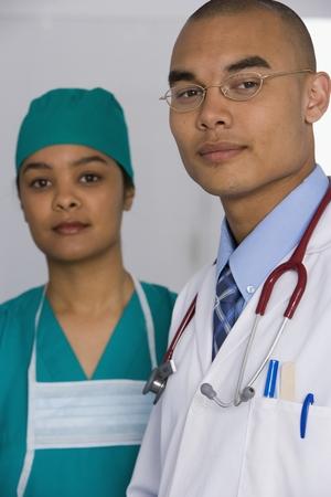 scrub cap: Portrait of multi-ethnic doctors