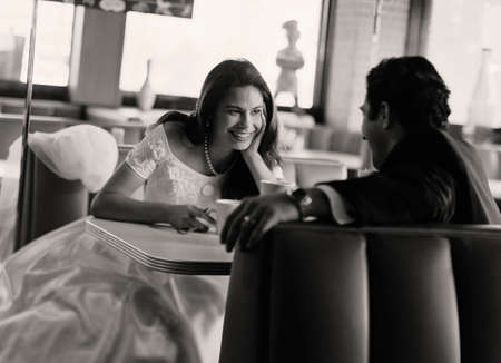 seriousness skill: Bride and groom eating at diner