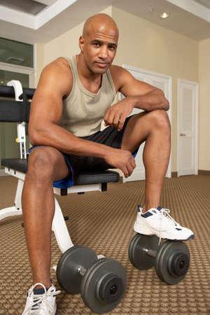 frustrating: Mixed Race man at health club
