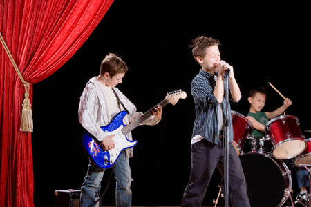 Multi-ethnic boys performing in band