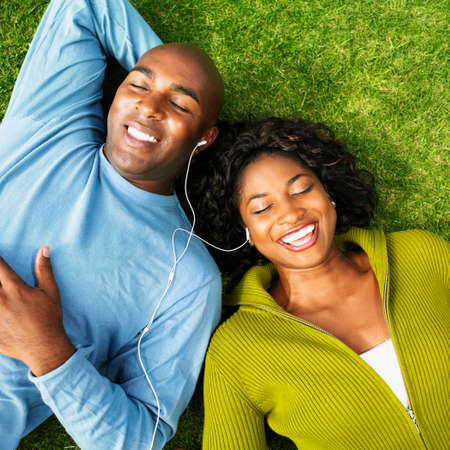 african descent ethnicity: African couple listening to same mp3 player