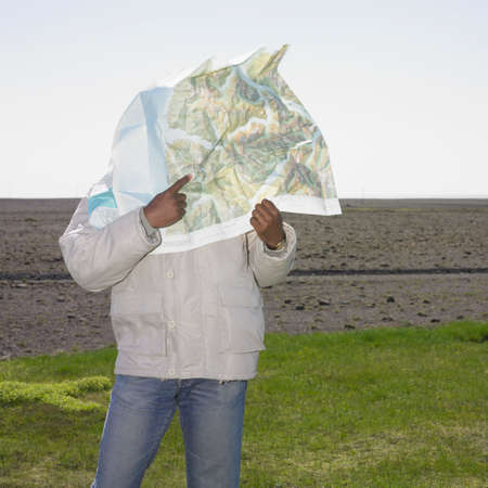 telecommuter: African man with map blowing in face