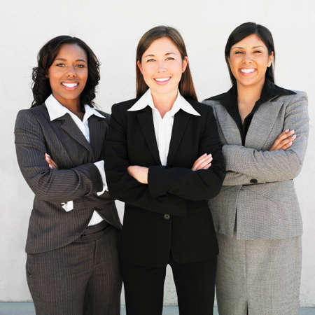 only 1 woman: Multi-ethnic businesswomen with arms crossed