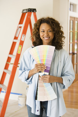 davenport: African woman holding paint swatches