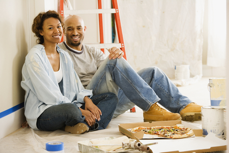 africanamerican: African couple taking lunch break from painting