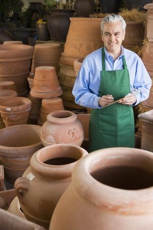 grampa: Hispanic man working at garden center
