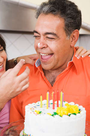 mischievious: Middle-aged man celebrating birthday LANG_EVOIMAGES
