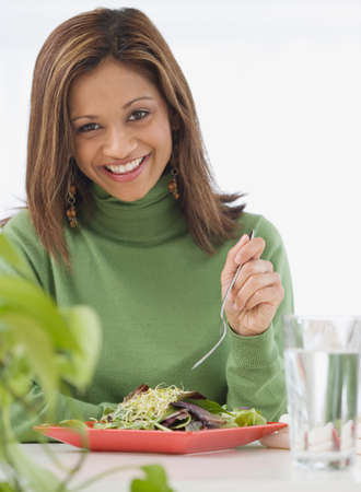 jeopardizing: Indian woman eating salad LANG_EVOIMAGES