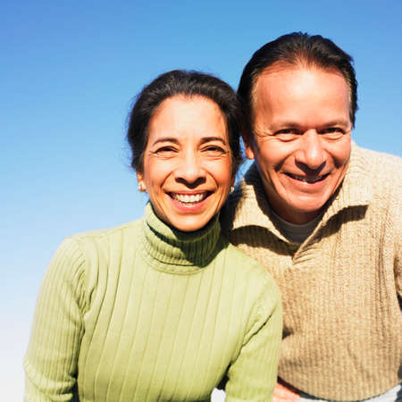 typist: Close up of Hispanic couple outdoors LANG_EVOIMAGES