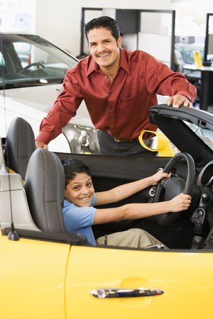 poppa: Hispanic father and son looking at new car