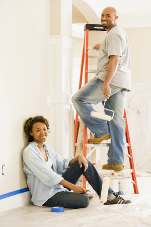 mischeif: African couple painting indoors