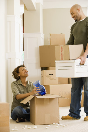 talker: African couple unpacking in new house