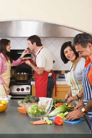 entertaining area: Group of middle-aged friends cooking