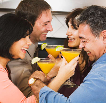 honeymooner: Two middle-aged couples drinking cocktails LANG_EVOIMAGES