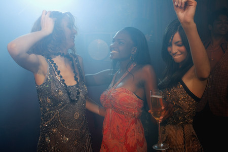 Multi-ethnic women dancing at nightclub