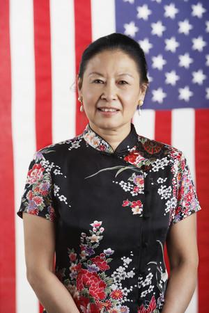 bathingsuit: Senior Asian woman standing in front of American flag