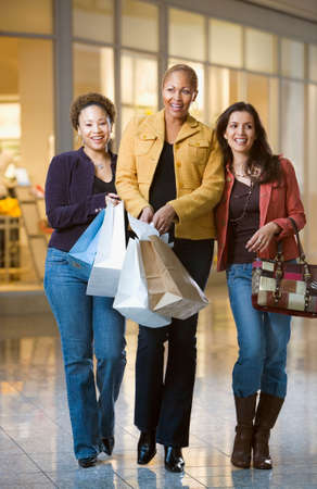 shopping buddies: Ethnic-ethnic women with shopping bags