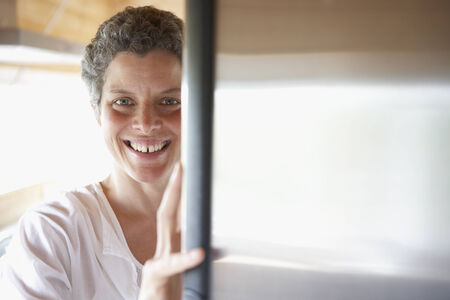 searcher: Mixed Race woman looking in refrigerator LANG_EVOIMAGES