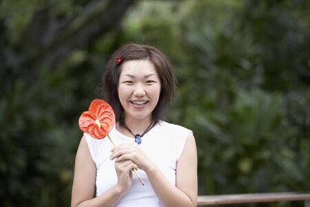 gramma: Asian woman holding flower