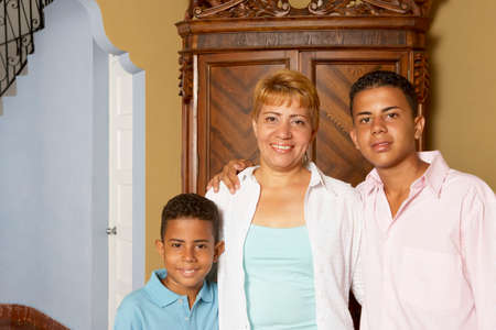 race relations: Hispanic mother and sons hugging