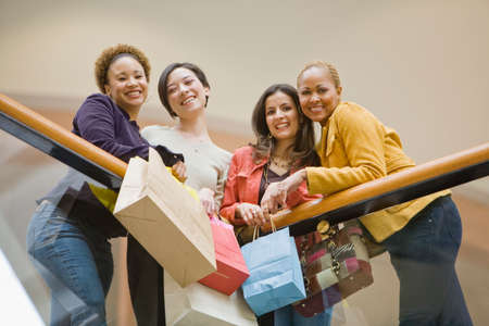 shopping buddies: Multi-ethnic women with shopping bags