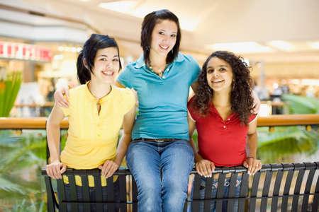 three generations of women: Multi-ethnic teenagers in mall