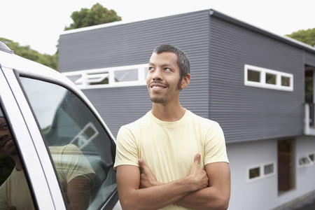 Native American man leaning on car Stock Photo